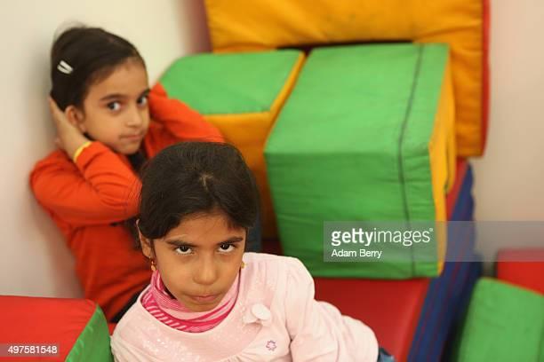 Refugee children from Iraq play in the children's area of an airdome used as a temporary shelter for refugees on September 26 2015 in Berlin Germany...