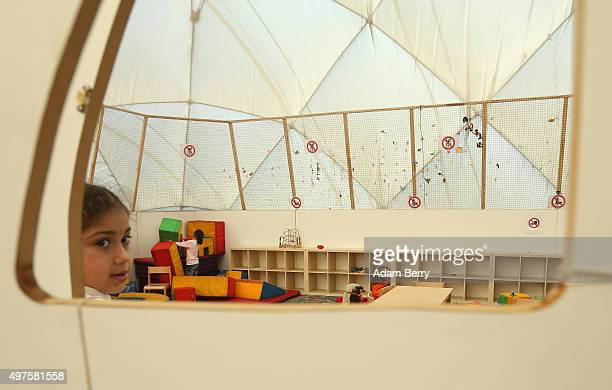 Refugee children from Syria and Iraq play in the children's area of an airdome used as a temporary shelter for refugees on September 26 2015 in...