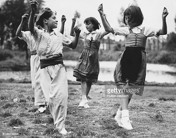 Refugee children from the Basque region of northern Spain rehearse a traditional Jota dance for a performance at the open air theater in West Ham The...