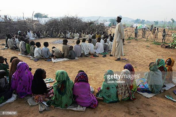 Refugee children from the Darfur region of Sudan attend an informal madrassa established by the residents of the spontaneous overflow camp outside...