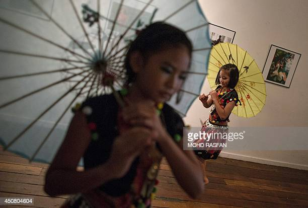 Refugee children from the Shan refugee community in Myanmar rehearse before the United Nations High Commission for Refugees event ahead of the...