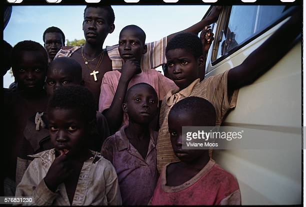 Refugee children gather in the compound of Bishop Nathaniel Garang leader of the Diocese of Bor Civil war and widespread famine have ravaged Sudan...