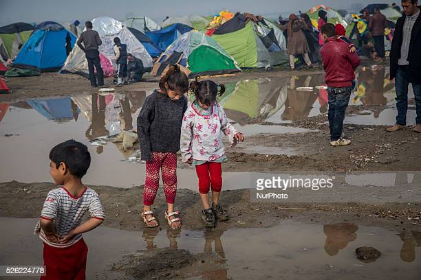 Refugee children played in puddles and mud that formed after a heavy rainfall the previous night. More than 13,000 people, mainly Syrian and Iraqi...
