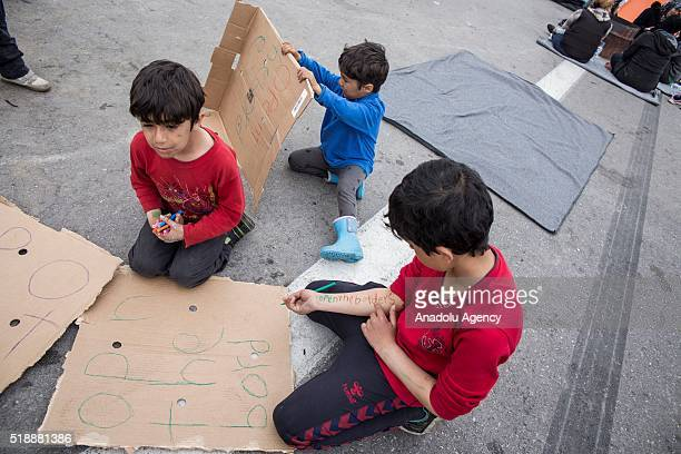 Refugee children prepare banners for the protests in EKO station at Polykastro town in Kilkis Greece on April 3 2016