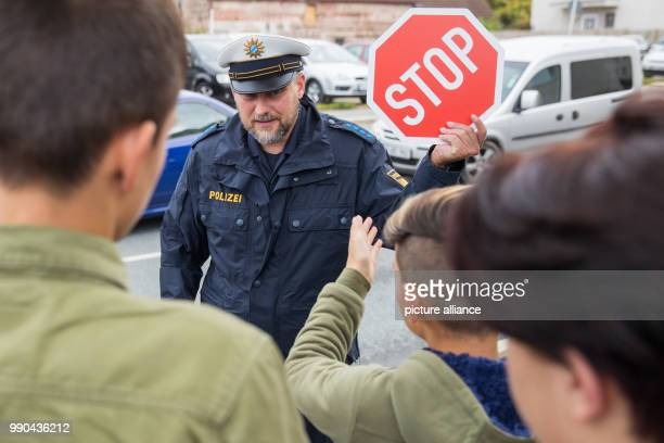 ARCHIVE Refugee children receive a lesson in traffic rules from police officer and traffic educator Markus Dieret Zirndorf Germany 15 September 2017...