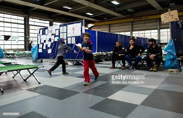 Refugee children Rehana and Arash from Afghanistan play at the PaulHallen registration centre for asylum seekers in Passau southern Germany on...