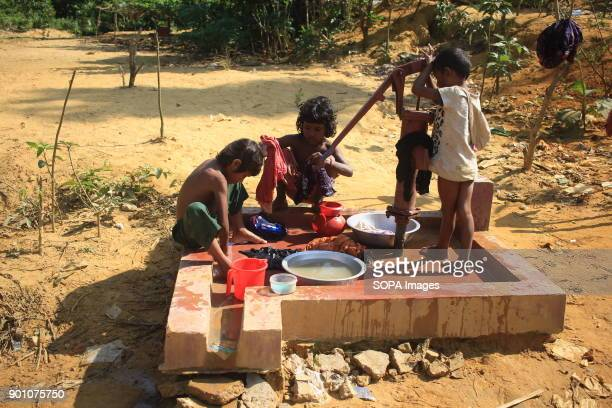 Refugee children seen washing their clothes with limited water supply More than 600000 Rohingya refugees have fled from Myanmar Rakhine state since...