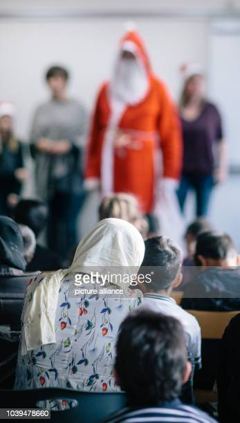 Refugee children take part in a Santa Claus celebration at an accommodation facility for asylum seekers inHoyerswerda Germany 05 December 2015...