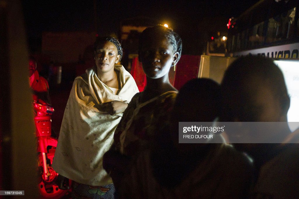 A refugee (L) coming from Gao stands in the street on January 19, 2013 in San. West African leaders Saturday sought urgent financial and logistical aid from the United Nations for a regional force in Mali to boost a French-led offensive against Islamists bearing down from the north.