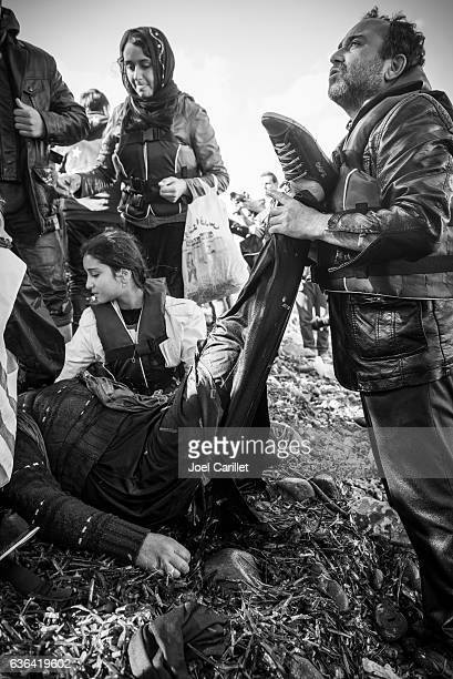 refugee crisis and arrivals on beach on lesbos, greece - kurdish girl stock photos and pictures