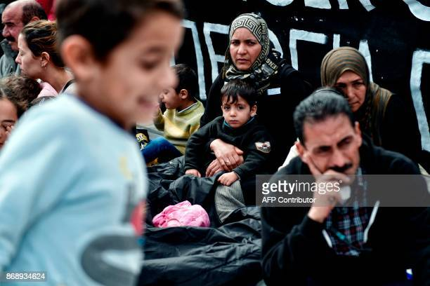 Refugee families granted asylum protest against delays in reuniting with their relatives mainly in Germany in front of the Greek parliament in Athens...