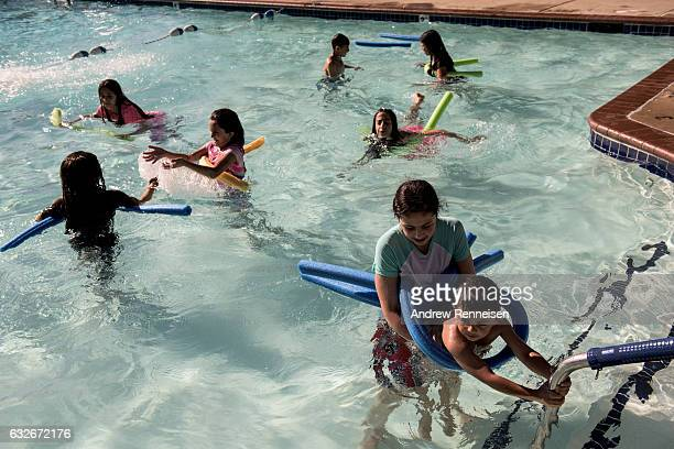 Refugee families play in the neighborhood community pool on August 1 2015 in Bloomfield Hills Michigan The majority of the children did not know how...