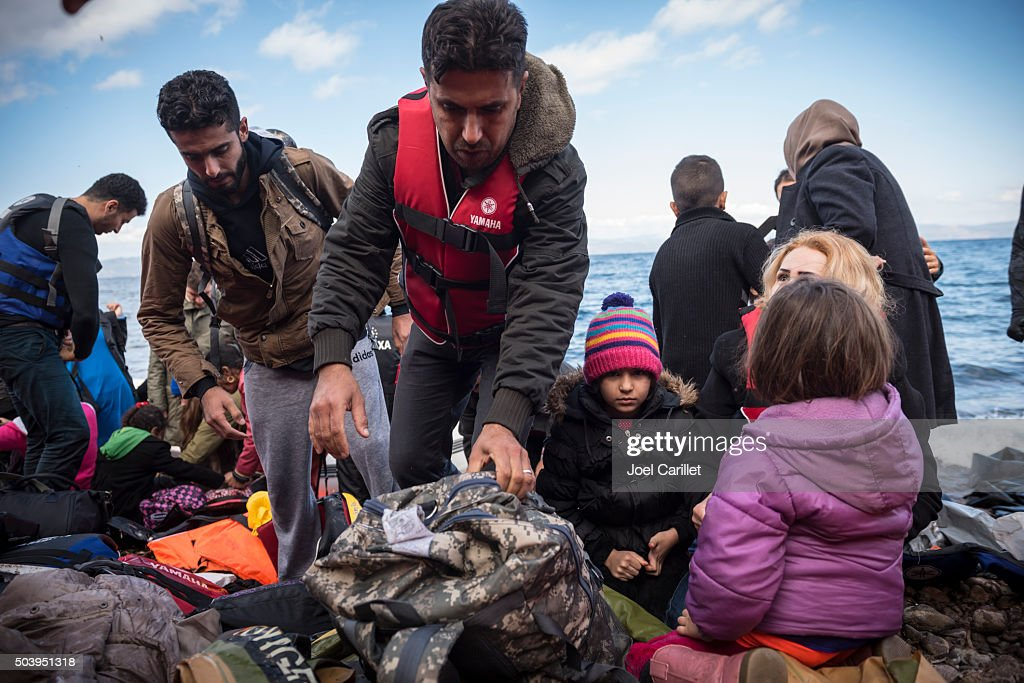 Refugee family arriving on Lesbos, Greece : Stock Photo