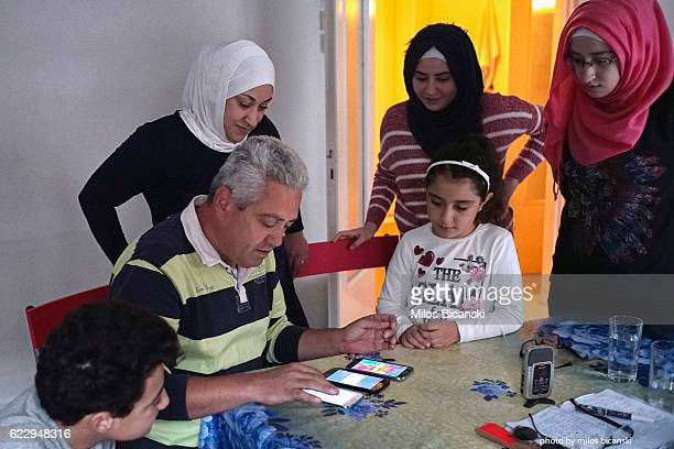 Refugee family from Syria Hassan Asaaid Alkhateb and Lama Asaaid Alkhateb and their children Mohamed Fatima Sham and Doha try to connect to internet...