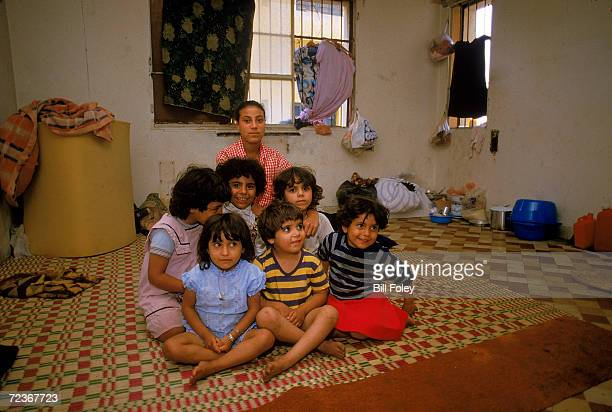 Refugee family living in the remains of the old US Embassy which was car bombed in April of 1983 it is now home to Lebanese and Palestinian refugees