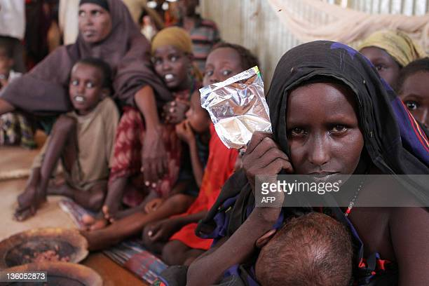 Refugee Fatuma Abdille poses at the Transit Centre in Dolo Ado Ethiopia on December 15 2011 Over 300000 refugees have fled severe drought conflict...