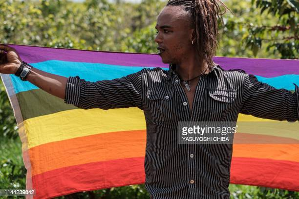 Refugee from DR Congo holds a rainbow flag during their protest to demand their protection at the office of the United Nations High Commissioner for...