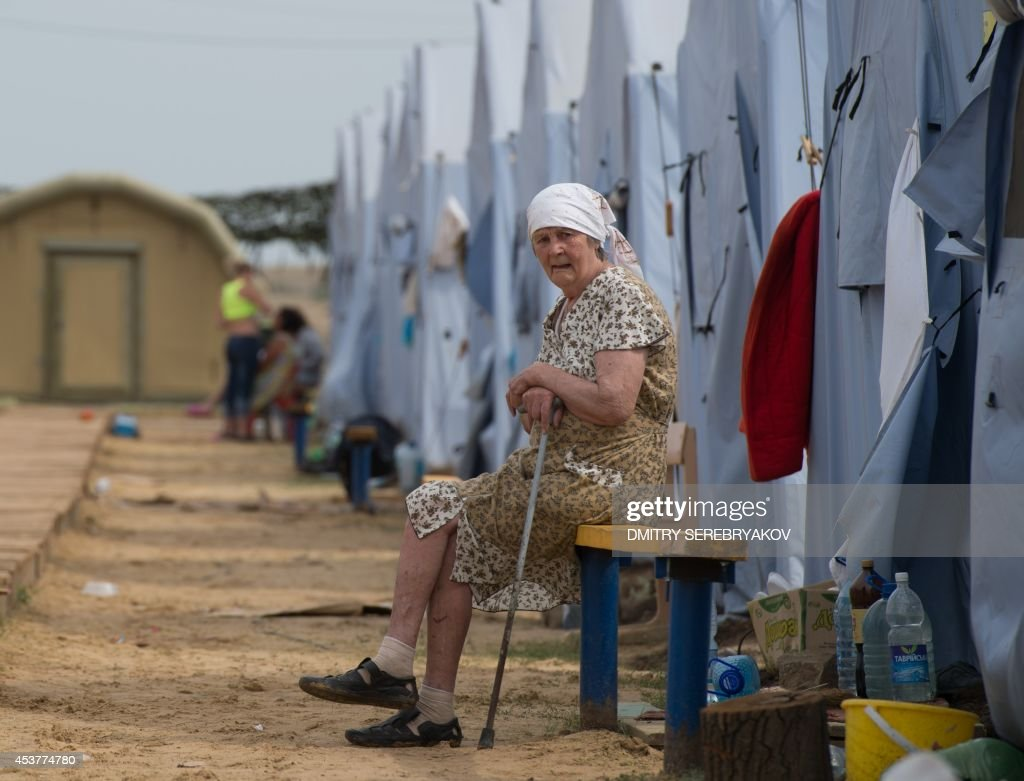 A refugee from eastern Ukraine looks on as she sits in a refugee camp near the Russian city of Donets'k, Rostov region, about 15 kilometers from the Russian-Ukrainian border. Some 285,000 people have already fled their homes due to the conflict in east Ukraine, it is estimated, with many leaving for other parts of the country, but close to 168,000 seeking sanctuary in Russia.