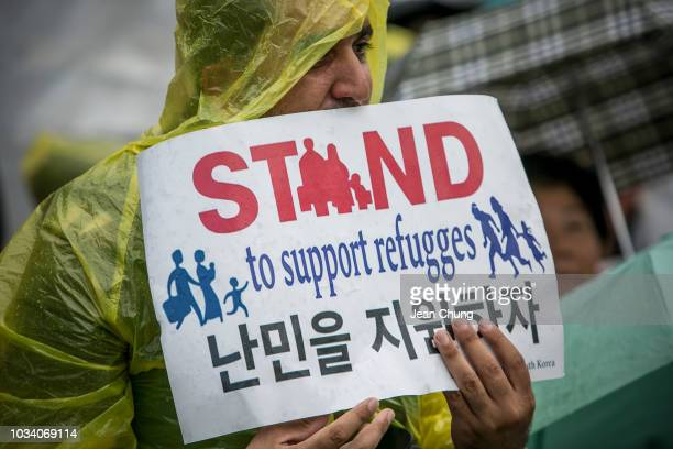 A refugee from Egypt holds a sign pleading for support for refugees on September 16 2018 in Seoul South Korea Activists gathered to protest for and...