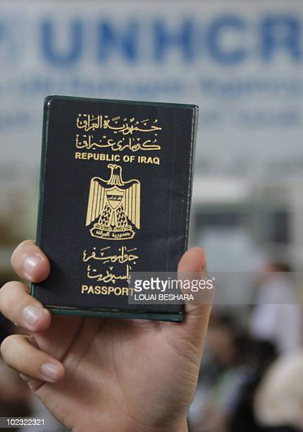 A refugee from Iraq holds his passport as he waits for his turn to discuss an issue at the United Nations High Commissioner for Refugees offices in...