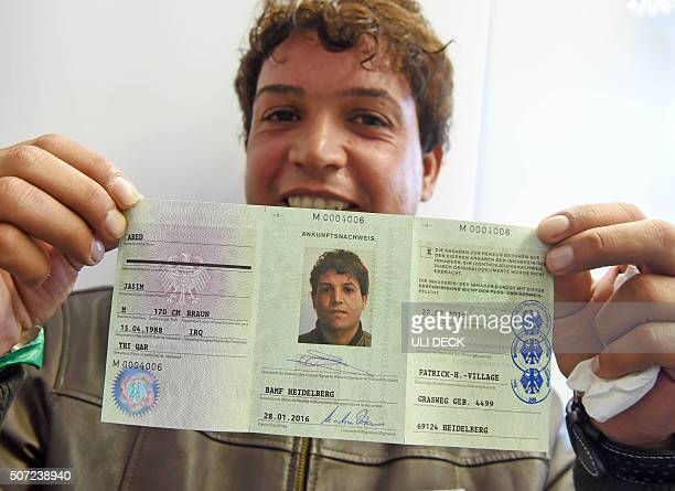 Refugee from Iraq Jasim Abed presents his 'Ankunftsnachweis' a kind of passport attesting him his registration in Germany on January 28 2016 in...