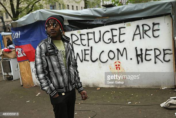A refugee from Niger stands by near huts that were being torn down at a temporary citytolerated refugee camp at Oranienplatz in Kreuzberg district on...