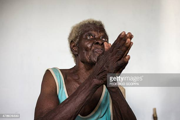 A refugee from the Central African Republic who was accused of practicing witchcraft by neighbours talks with humanitarian personnel in a UNHCR...