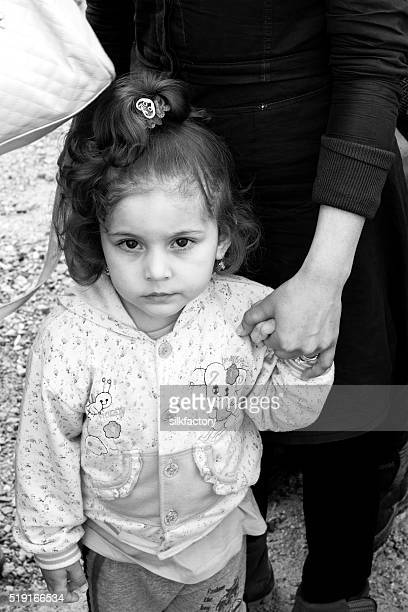 Refugee girl and refugee mother in breakfast line