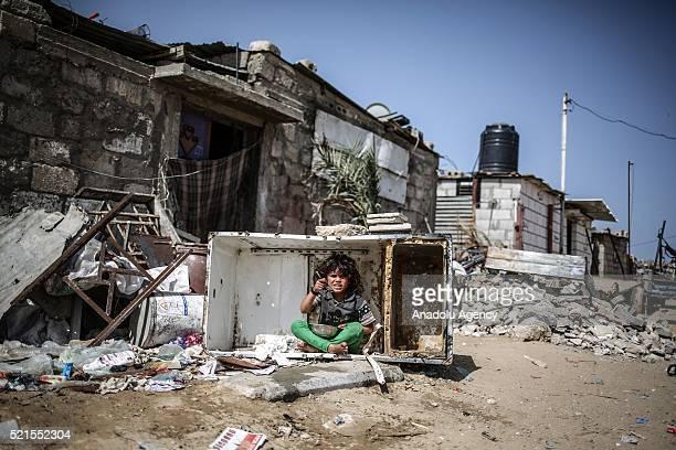 Refugee girl eats food on street at Khan Yunis refugee camp, in Khan Yunis, Gaza on April 16, 2016. Khan Yunis Camp was established after the 1948...