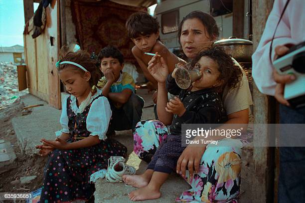 A refugee Gypsy family on the porch of their temporary home outside of Rome as a result of Gypsies being the target of antiimmigrant attacks...