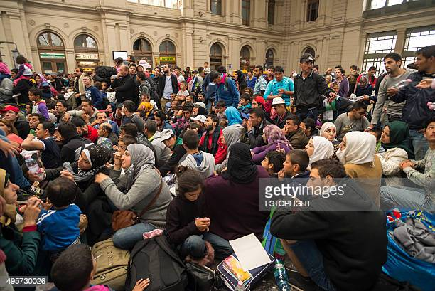 refugee in train station - 2015 stock pictures, royalty-free photos & images
