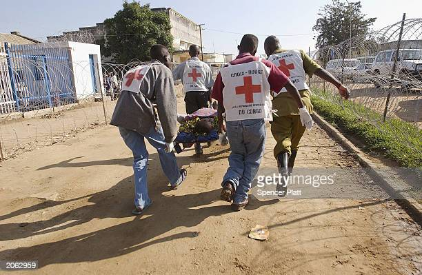 A refugee is evacuated on a stretcher from the United Nations Compound amid heavy fighting June 7 2003 in Bunia Democratic Republic of Congo French...