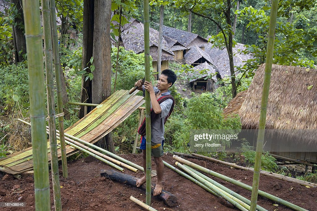 A refugee man who fled from the Shan State in Burma builds a new bamboo home on the steep hillside of the refugee camp. He had been in the camp for two months before receiving permission and materials to build. More than 2,000 refugees have arrived in Thailand from Burma in the last four months, claiming they are fleeing violence and human rights abuse. Already, 140,000 refugees from Burma live in nine refugee camps in Thailand. Many have lived in the camps for up to 20 years..