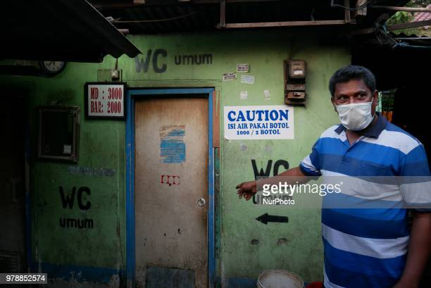 A refugee need to pay for a toilet as they settling on the roadside in front of the overcapacity immigration detention house in Jakarta Indonesia on...