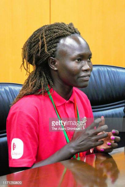Refugee Olympic Team Athlete Rose Lokonyen of South Sudan speaks to Olympic Minister Shunichi Suzuki during their meeting on August 29, 2019 in...