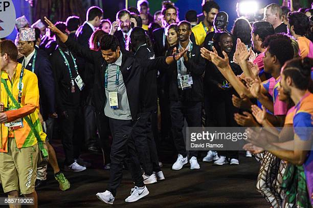 Refugee Olympic Team athletes for the Rio 2016 Olympic Games attend their welcome ceremony at the Athletes village on August 3 2016 in Rio de Janeiro...