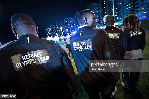 Refugee Olympic Team athletes for the Rio 2016 Olympic Games attend their welcome ceremony at the Athletes village on August 3, 2016 in Rio de...