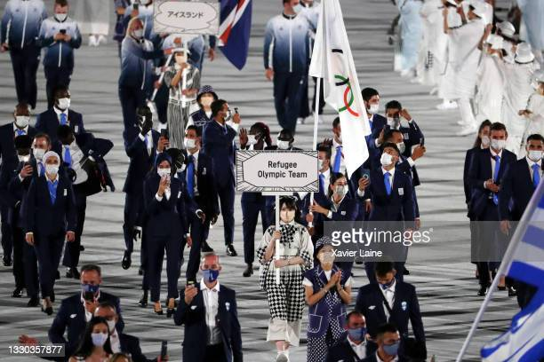 Refugee Olympic Team walk in the parade during the Opening Ceremony of the Tokyo 2020 Olympic Games at Olympic Stadium on July 23, 2021 in Tokyo,...