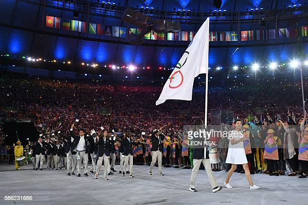 Refugee Olympic Team's flag bearer Rose Nathike Lokonyen leads the delegation during the opening ceremony of the Rio 2016 Olympic Games at the...