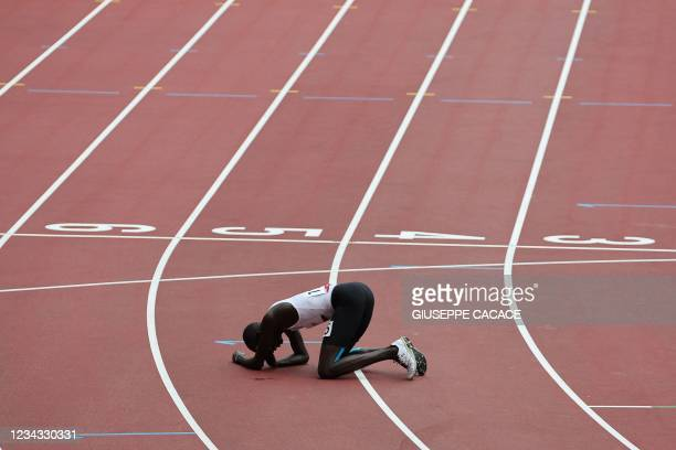 Refugee Olympic Team's James Nyang Chiengjiek reacts afte falling during the men's 800m heats during the Tokyo 2020 Olympic Games at the Olympic...