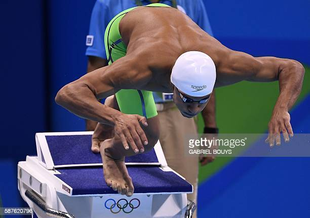 Refugee Olympic Team's Rami Anis competes in the Men's 100m Freestyle heat during the swimming event at the Rio 2016 Olympic Games at the Olympic...