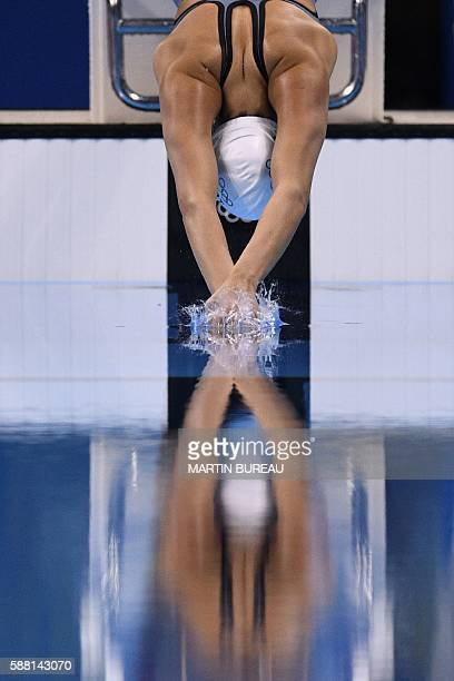 Refugee Olympic Team's Yusra Mardini competes in a Women's 100m Freestyle heat during the swimming event at the Rio 2016 Olympic Games at the Olympic...