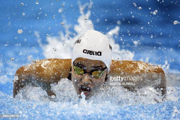Refugee Olympic Team's Yusra Mardini takes part in the Women's 100m Butterfly heat during the swimming event at the Rio 2016 Olympic Games at the...