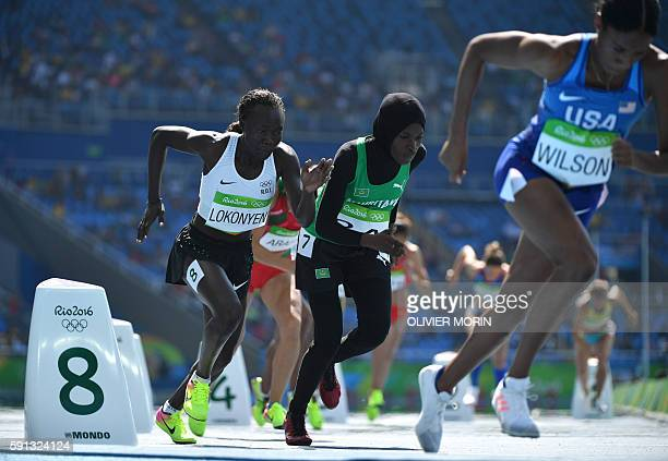 Refugee OlympicTeam's Nathike Rose Lokonyen and Mauritania's Houleye Ba compete in the Women's 800m Round 1 during the athletics event at the Rio...
