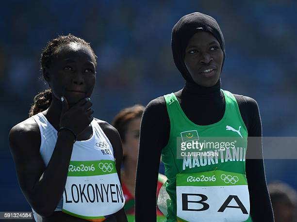 Refugee OlympicTeam's Nathike Rose Lokonyen and Mauritania's Houleye Ba prepare to compete in the Women's 800m Round 1 during the athletics event at...