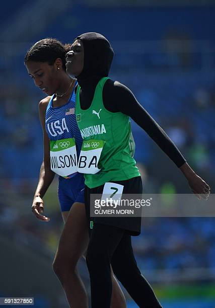 Refugee OlympicTeam's Nathike Rose Lokonyen and Mauritania's Houleye Ba react after competing in the Women's 800m Round 1 during the athletics event...