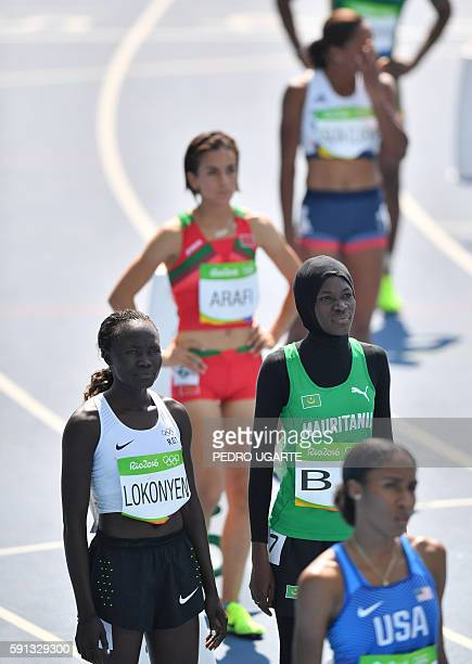 Refugee OlympicTeam's Nathike Rose Lokonyen and Mauritania's Houleye Ba look on after competing in the Women's 800m Round 1 during the athletics...
