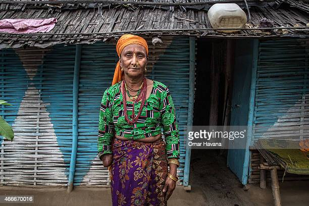 A refugee poses in front of her house in the Beldangi 2 refugee camp on March 14 2015 in Beldangi Nepal More than 22000 Bhutanese refugees still...