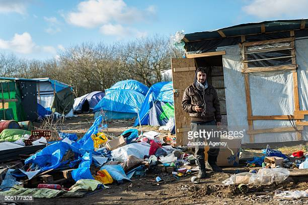 Refugee prepares to relocate from the camp known as the Jungle on January 15, 2015 in Calais, France. French police have given residents a deadline...