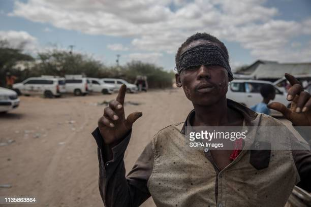 Refugee seen posing for a picture in the refugee camp. Dadaab is one of the largest refugee camps in the world. More than 200,000 refugees live there...